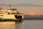 A Washington state ferry crosses Puget Sound near Mukilteo as Mount Baker looms in the background.