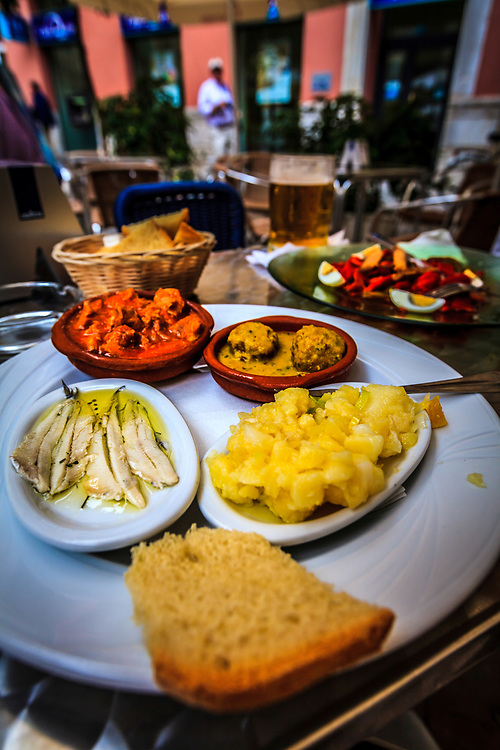 Tapas make a full meal in Malaga, Spain. Tapas have evolved into an entire, and sometimes sophisticated, cuisine.