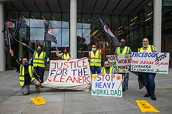 Night-shift cleaners belonging to the Cleaners and Allied Independent Workers Union (CAIWU) protest outside the UK headquarters of Facebook on 5th August 2021 in London, United Kingdom. The cleaners are outsourced via the Churchill Group to clean the Facebook offices and CAIWU claims that five additional floors have been added to their workload, that cleaners who have left have not been replaced and that sickness and holiday cover has not been provided.