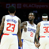 LOS ANGELES, CA - OCT 09: Patrick Beverley (21) of the LA Clippers celebrates with Lou Williams (23) of the LA Clippers during a pre-season game on October 09, 2018 at the Staples Center in Los Angeles, California.