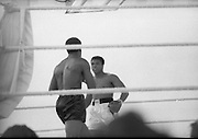 Ali vs Lewis Fight, Croke Park,Dublin..1972..19.07.1972..07.19.1972..19th July 1972..As part of his built up for a World Championship attempt against the current champion, 'Smokin' Joe Frazier,Muhammad Ali fought Al 'Blue' Lewis at Croke Park,Dublin,Ireland. Muhammad Ali won the fight with a TKO when the fight was stopped in the eleventh round...Photograph taken as both fighters size each other up..
