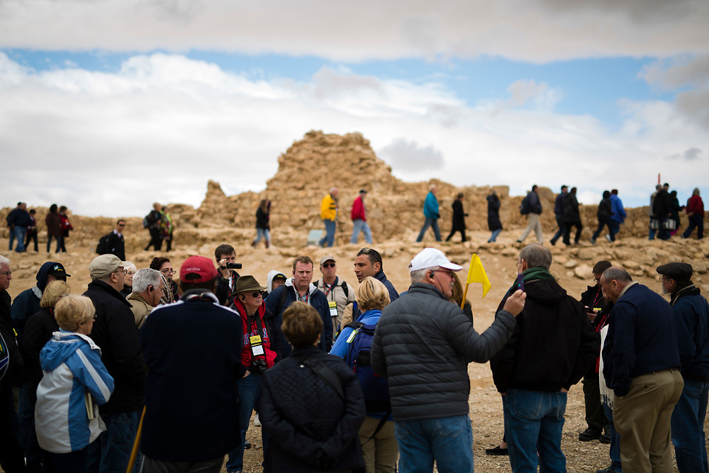 American Evangelical Christian tourists and pilgrims led by Former Arkansas governor Mike Huckabee (not pictured) are seen as they visit the ancient hilltop fortress of Masada in the Judean desert in Israel, on February 19, 2015. The ancient ruined desert fortress on a wind-swept plateau overlooking the Dead Sea is seen by many as an emblem of Israel's fighting spirit, it is believed to be the place where close to a thousand Jewish rebels killed themselves and each other about two millennia ago, rather than surrender and fall into slavery under the Romans.