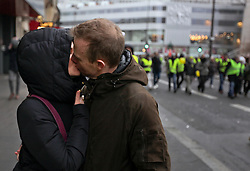 19 January 2019. Paris, France.<br /> Gilets Jaunes - Acte X take to the streets of Paris. Love on the march, a couple kiss as they march with the Gilets jaunes. An estimated 7,000 people took part in the looping 14 km route from Place des Invalides to protest tax hikes from the Government of Emmanuel Macron imposed on the people. An estimated 80,000 people took part in protests across the country. Regrettably the movement has attracted a violent element of agitators who often face off with riot police at the end of the marches which tends to deflect attention away from the message of the vast majority of peaceful protesters.<br /> Photo©; Charlie Varley/varleypix.com