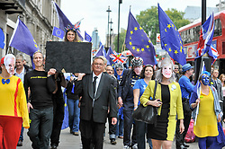 © Licensed to London News Pictures. 14/10/2017. London, UK. Anti-Brexit protestors stage a march down Whitehall to Westminster carrying a mock coffin representing the death of democracy.  Protestors carried European flags and were joined by others wearing masks of David Davis, Theresa May and Boris Johnson.   Photo credit : Stephen Chung/LNP