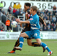 Photo: Ed Godden.<br />Reading v Wolverhampton Wanderers. Coca Cola Championship. 18/03/2006. <br />Kevin Doyle (R) is held off the ball by Wolves player Joleon Lescott.