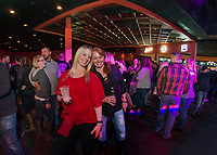 """Kate Dobens and Sandy Jordan sing along to """"My Church"""" with the Jodie Cunningham Band Saturday night during the Whiskey Barrel's opening weekend in downtown Laconia.  (Karen Bobotas/for the Laconia Daily Sun)"""