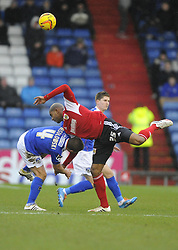 Bristol City's Marvin Elliott battles for the ball with Oldham Athletic's James Wesolowski - Photo mandatory by-line: Joe Meredith/JMP - Tel: Mobile: 07966 386802 08/02/2014 - SPORT - FOOTBALL - Oldham - Boundary Park - Oldham Athletic v Bristol City - Sky Bet League One