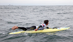 © Licensed to London News Pictures. English Channel. UK 27/07/2011. Toby Lowe pictured. Surf Relief UK paddlers Dave Manley, Nick Thorn, Phil Williams and Toby Lowe paddle surf boards across the 22 miles of the English Channel from Shakespeare Beach, Dover to Cap Gris Nez in France yesterday (26/07/2011). The team smashed their previous predicted 6 hour time, crossing in 5 hours 20 minutes. The team will raise more than £3000 for Surf Relief UK which provides surfing lessoms for disabled and disadvantaged children across the UK. Photo credit: Manu Palomeque/LNP