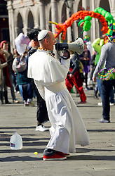 09 February 2016. New Orleans, Louisiana.<br /> Mardi Gras Day. A man dressed as the Pope confronts rude and abusive fundamentalist Christians spewing their messages of hate at St Louis Cathedral. <br /> Photo©; Charlie Varley/varleypix.com