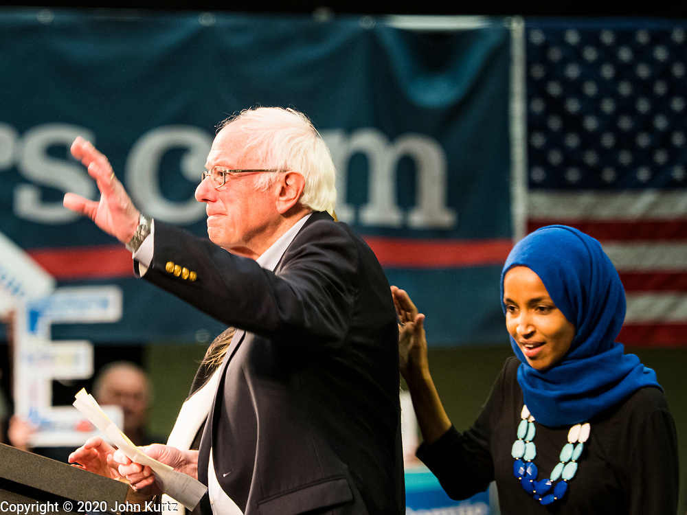 02 MARCH 2020 - ST. PAUL, MINNESOTA: US Senator BERNIE SANDERS (Ind-VT) waves after Rep. ILHAN OMAR (right) introduced him at a Get Out the Vote rally in the RiverCentre in St. Paul. More than 8,400 people attended the rally. Minnesota is a Super Tuesday state this year and Minnesotans will go to the polls Tuesday. Minnesota Sen. Amy Klobuchar was expected to win her home state, but she dropped out early Monday, March 2.          PHOTO BY JACK KURTZ