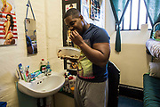 A prisoner eating his lunch standing up in his cell. HMP/YOI Portland, Dorset. A resettlement prison with a capacity for 530 prisoners. Portland, Dorset, United Kingdom.