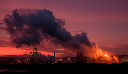 © Licensed to London News Pictures. <br /> 09/12/2014. <br /> <br /> Teesside, United Kingdom<br /> <br /> A beautiful sunrise starts the day and casts a warm glow over the steel works on Teesside. Strong winds are expected to pick up through the day as the winter weather continues.<br /> <br /> <br /> Photo credit : Ian Forsyth/LNP