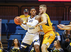 Nov 24, 2018; Morgantown, WV, USA;  West Virginia Mountaineers forward Sagaba Konate (50) looks to pass while defended by Valparaiso Crusaders center Derrik Smits (21) during the first half at WVU Coliseum. Mandatory Credit: Ben Queen-USA TODAY Sports