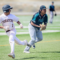Tohatchi Cougar Brandon Lucero (2), left, escapes a tag on the way to third base after Navajo Prep Eagle Brandon Smith (5) scoops an infield ground ball at the Gallup Sports Complex in Gallup Saturday.
