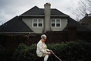 """HOOVER, AL – MARCH 1, 2016: Sherry Barrington, 85, walks her dogs Sadie and Josie on Chapel Road outside the perimeter of the Ivy Chade Circle community, where she has lived for 19 years. """"I'm afraid of these wild ideas out there, Barrington said. """"The economy is important to me, and security in our country. So if I'm gonna fuss about something I at least need to participate. I took the lesser of the evils this election.""""<br /> <br /> On Super Tuesday, voters in the economically vibrant city of Hoover turned out to voice their support for a presidential candidate. Located in the Appalachian foothills, Hoover is the largest suburb of Birmingham and is home to several planned communities with idyllic neighborhoods tailored for the upper middle class. CREDIT: Bob Miller for The Wall Street Journal<br /> OLDCITIES"""