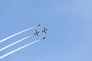 Canadian Forces Snowbirds performing the Double Take manoeuvre with smoke.  This formation shows both the upper and lower side of the jets.  The Snowbirds are also known as the 431 Air Demonstration Squadron and fly the Canadair CT-114 Tutor jet. Photographed during the Canada 150 celebrations in White Rock, British Columbia, Canada.