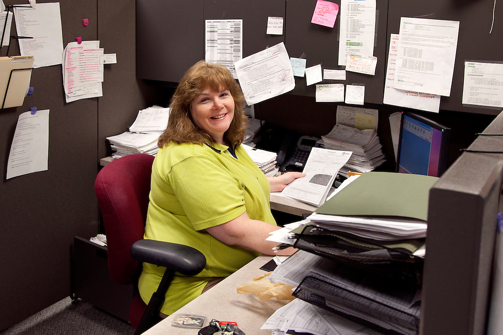 woman customer service office worker for waste management company at her desk