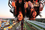 """From left, Maria Monsalve, 14, and Jessica Ortega, 12, both from Orlando, take a spin on the Fire Ball ride during the Osceola County Fair on Monday, February 14, 2011. """"It felt like you were flying,"""" Ortega said."""