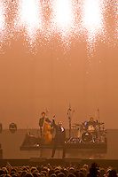At the end of his opening number, Cry Me a River, Michael Buble punched his fist into the air and opened the  pyrotechnic sky to rain down on him.