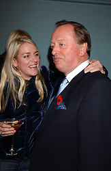 LAURA PARKER BOWLES and her father ANDREW PARKER BOWLES at a party to celebrate the publication of 'E is for Eating' by Tom Parker Bowles held at Kensington Place, 201 Kensington Church Street, London W8 on 3rd November 2004.<br />