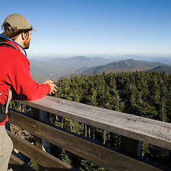 Taking in the view towards Sunday River Whitecap from the fire tower on the summit of Old Speck Mountain in Maine's Grafton Notch State Park. MR