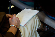A women takes notes during a town hall meeting hosted by Keller ISD to discuss adding a $175 million bond election to the November ballot in Keller, Texas on August 11, 2014. (Cooper Neill for The Texas Tribune)