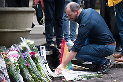 © Licensed to London News Pictures. 13/06/2016. London's gay village light candles in St Anne's church to honour victims of Pulse shooting in the United States.  It is alleged that The gunman, Omar Mateen killed at least 50 people in Pulse nightclub in Florida, USA.  London, UK. Photo credit: Ray Tang/LNP