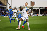 Coventry City forward Amadou Bakayoko controls the ball with his shoulder in front of Peterborough Utd midfielder Ben White (6) during the EFL Sky Bet League 1 match between Peterborough United and Coventry City at London Road, Peterborough, England on 16 March 2019.