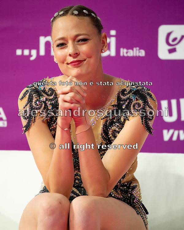Nicol Ruprecht sitting at the Kiss and Cry of the Rhythmic Gymnastics World Cup in Pesaro.
