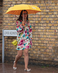 © Licensed to London News Pictures. 27/08/2020. London, UK. Members of the public get caught in torrential rain and flash flooding in Putney in South West London as thunderstorms hit London and the South East. The Met Office have issued yet another yellow weather warning for thunderstorms with heavy rain and potential disruption to transport over the next 24 hours. Photo credit: Alex Lentati/LNP