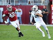 TUSCALOOSA, AL - NOVEMBER 10:  Quarterback Johnny Manziel #2 of the Texas A&M Aggies runs downfield while linebacker Adrien Hubbard #42 of the Alabama Crimson Tide pursues him during the game at Bryant-Denny Stadium on November 10, 2012 in Tuscaloosa, Alabama.  (Photo by Mike Zarrilli/Getty Images)