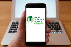Using iPhone smartphone to display logo of the Food Standards Agency (FSA)
