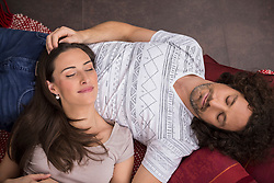 High angle view of mid adult couple sleeping on floor, Munich, Bavaria, Germany