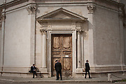 A party of groomsmen hanging out outside Santa Maria della Consolazione in Todi, Umbria, Italy. Full-color version also available upon request.