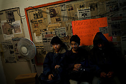 Young boys who were detained by US Border Patrol and returned to Mexico after a failed attempt to cross the border wait for lights out in a shelter.  These boys have little or no money and will spend the night in Nogales while they decide whether to return home or make another attempt at crossing.