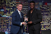 Los Angeles Rams linebacker Samson Ebukam (right) poses with Fox Sports football analyst Joel Klatt during the 14th LA Sports Awards in Beverly Hills, Calif., Monday, March 25, 2019. Ebukam was recognized as a part of the Rams 54-51 victory over the Kansas City Chiefs on Nov 20, 2018-the highest scoring game in Monday Night Football history-as the top sports moment of the year.