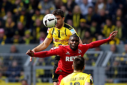 DORTMUND, April 30, 2017  Sokratis Papastathopoulos(Top) of Borussia Dortmund challenges with Anthony Modeste(C) of 1.FC Cologne during the Bundesliga soccer match between Borussia Dortmund and 1.FC Cologne at the Signal Iduna Park in Dortmund, Germany on April 29, 2017. The match ended in a 0-0 draw. (Credit Image: © Joachim Bywaletz/Xinhua via ZUMA Wire)