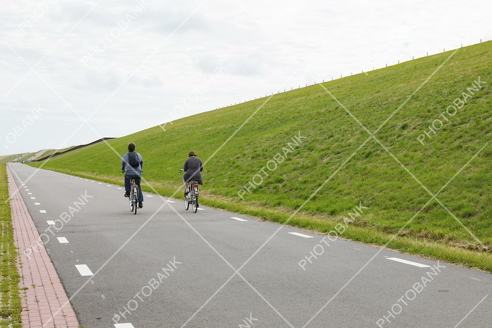 Bicycle trail surrounded by green hills
