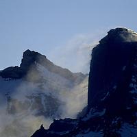 ANTARCTICA, Queen Maud Land. Wind-blown snow blows off Mt.Kubus, Filchner Mts.