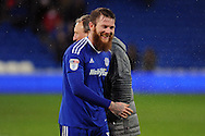 Cardiff City's Aron Gunnarsson shares a joke with manager Neil Warnock at the final whistle. EFL Skybet championship match, Cardiff city v Preston North End at the Cardiff City stadium in Cardiff, South Wales on Tuesday 31st January 2017.<br /> pic by Carl Robertson, Andrew Orchard sports photography.