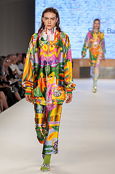 © Licensed to London News Pictures. 07/06/2016. London, UK. A model presents a look by Rhea Barry from Manchester University.  Graduate Fashion Week, day three, takes place at the Old Truman Brewery in East London.  The event showcases the work of over 1,000 of the very best graduates from over 40 universities around the world through 22 catwalk shows and more.  Photo credit : Stephen Chung/LNP