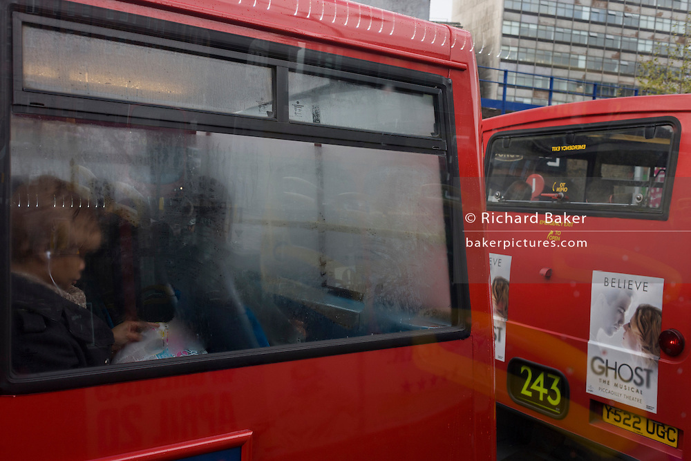 London bus passenger showing the everyday tedium of commuting in the UK capital and a romantic musical ad.