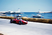 Formula One motor racing Monaco Grand Prix race 1961 Phil Hill in Ferrari 156 F1 sharknose car approaching tobacconist kiosk