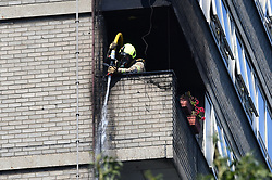 © Licensed to London News Pictures. 23/08/2019. London, UK. The scene where a fire had started at a flat in a tower block at Darfield Way in west London, just yards from Grenfell Tower. Photo credit: Ben Cawthra/LNP