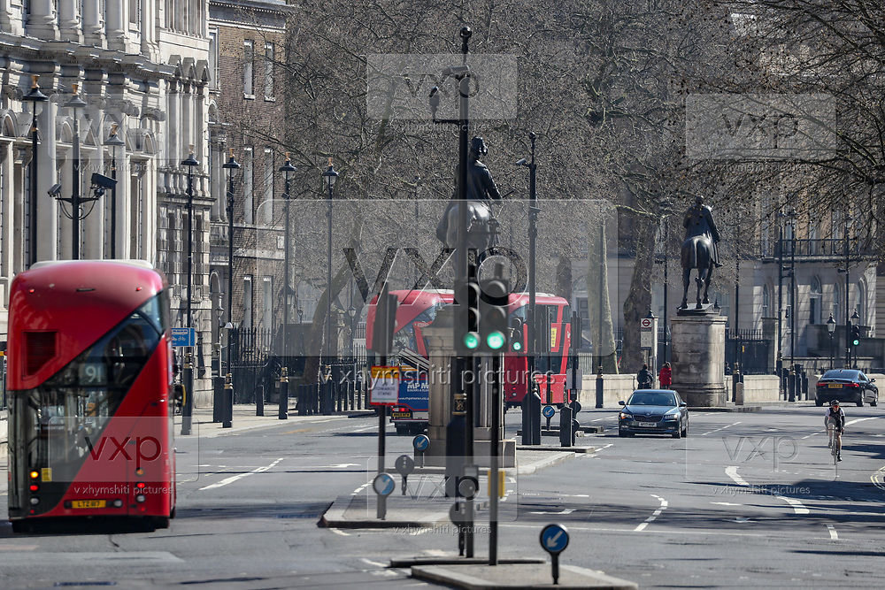 A general view of London Red Buses going towards Houses of Parliament from Trafalgar Square, Wednesday, March 25, 2020. British lawmakers voted to shut down Parliament for 4 weeks, due to the coronavirus outbreak. The new coronavirus causes mild or moderate symptoms for most people, but for some, especially older adults and people with existing health problems, it can cause more severe illness or death. (Photo/Vudi Xhymshiti)