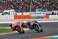 #93 Marc Marquez, Spanish: Repsol Honda Team takes the lead from #20 Fabio Quatararo, French: Petronas Yamaha SRT during the Gran Premio Motul de la Comunitat Valenciana at Circuito Ricardo Tormo Cheste, Valencia, Spain on 17 November 2019.