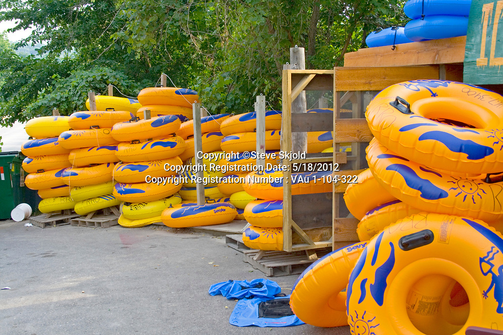 Large yellow inner tubes rented to people for floating down the Root River. Lanesboro Minnesota MN USA