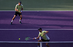 March 28, 2018 - Key Biscayne, Florida, United States - Bob and Mike Bryan, from the USA, in action during their quarter final match at the Miami Open. The Bryan brothers defeated M.Venus and R. Klaasen 3-6, 7-6(5), 10-8  in Miami, on March 28, 2018. (Credit Image: © Manuel Mazzanti/NurPhoto via ZUMA Press)