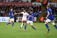 Neil Taylor of Swansea city is challenged by Riyad Mahrez. Barclays Premier league match, Swansea city v Leicester city at the Liberty stadium in Swansea, South Wales on Saturday 25th October 2014<br /> pic by Andrew Orchard, Andrew Orchard sports photography.