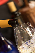 Close-up of white wine being poured into glass, Trieste, Italy